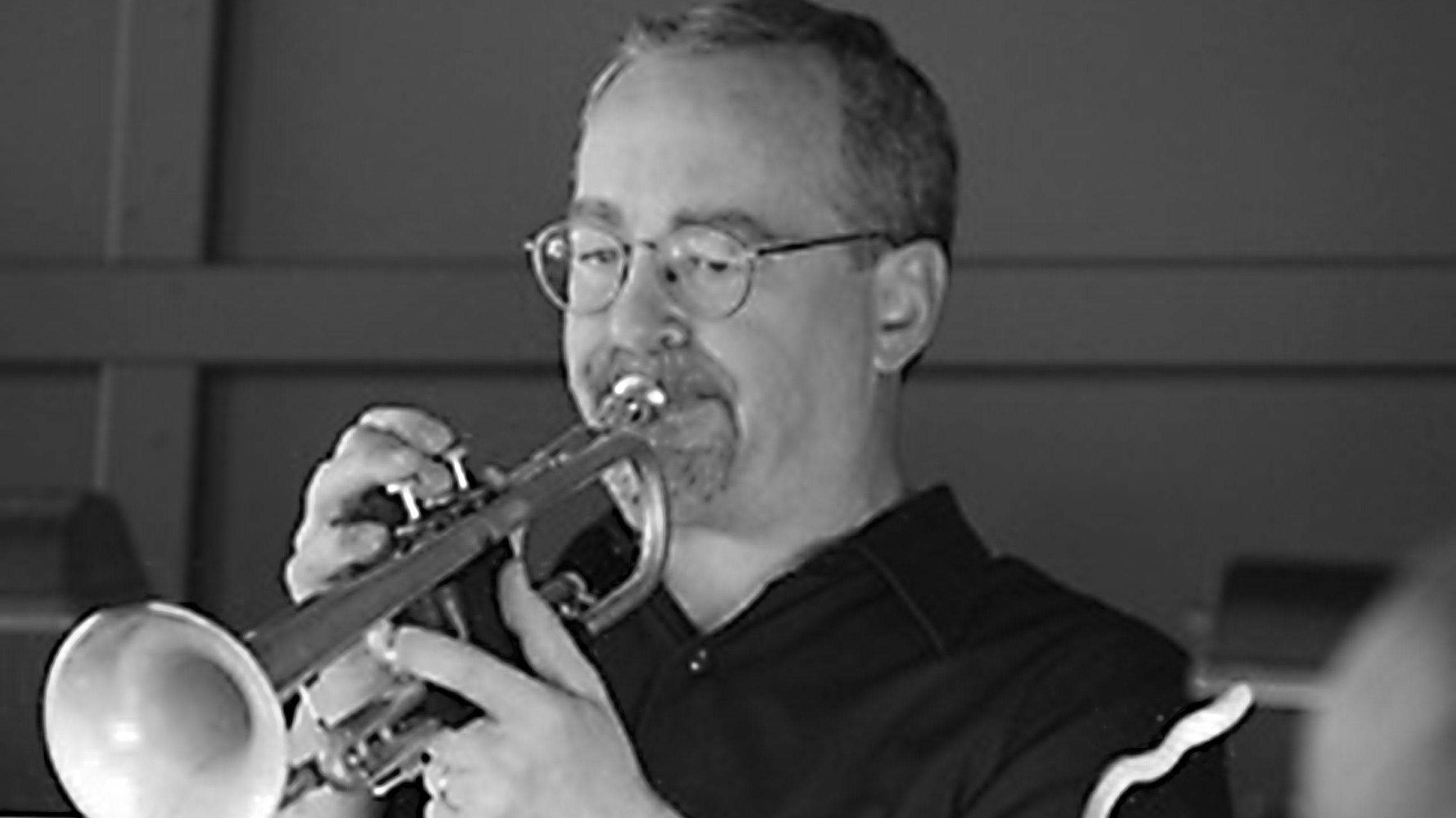 Jeff Folkens plays trumpet.