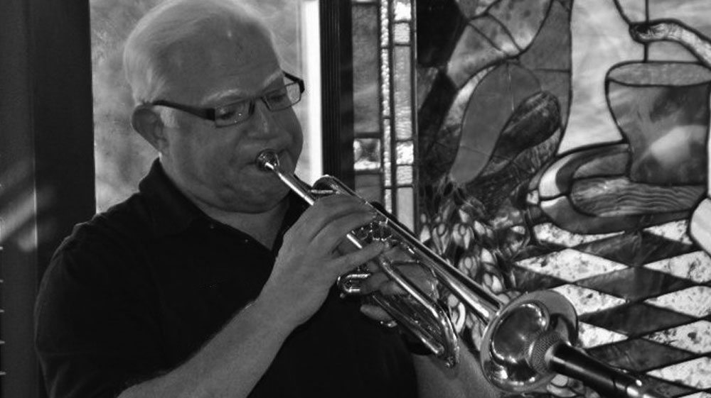 Hank Maunter plays his horn.